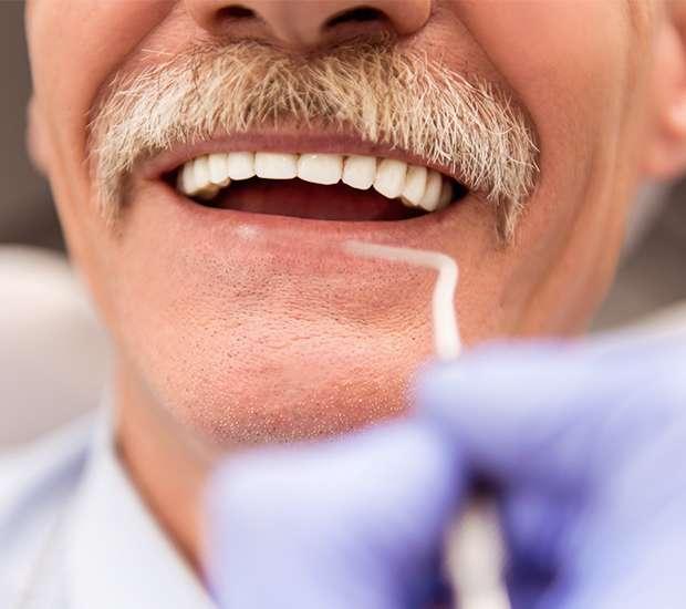 Paramus Adjusting to New Dentures